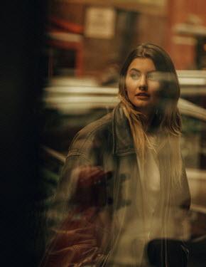 Maria Yakimova WOMAN REFLECTED IN WINDOW WALKING IN CITY Women