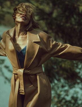 Maria Yakimova HAPPY WOMAN IN COAT BY WINDY RIVER Women