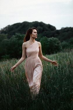 Elena Alferova BRUNETTE WOMAN IN EVENING DRESS WALKING IN COUNTRYSIDE Women