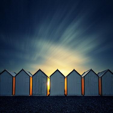 David Keochkerian ROW OF BEACH HUTS AT SUNSET Miscellaneous Buildings