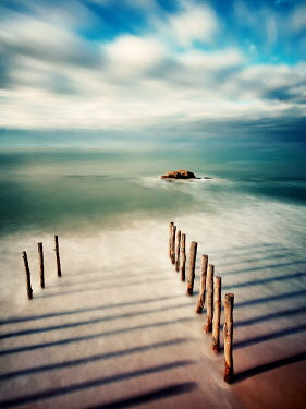 David Keochkerian MISTY BEACH WITH WWODEN POLES AND ROCKS Seascapes/Beaches