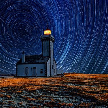 David Keochkerian LIGHTHOUSE AT NIGHT WITH SWIRLING STARS Miscellaneous Buildings