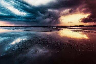 David Keochkerian SEA AND SANDBANK WITH STORMY SUNSET Seascapes/Beaches