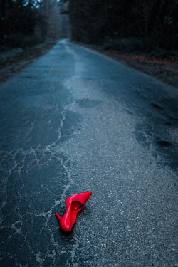 Magdalena Russocka RED STILETTO LYING ON COUNTRY ROAD