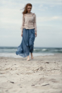 Magdalena Russocka woman walking on beach