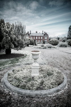 Nic Skerten Historical mansion house and gardens in snow
