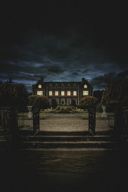Nic Skerten Light in windows of mansion at night