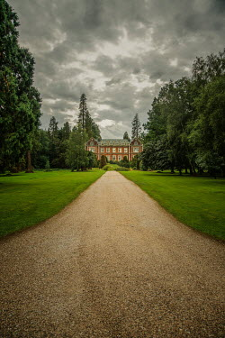 Nic Skerten mansion house at end of tree-lined driveway