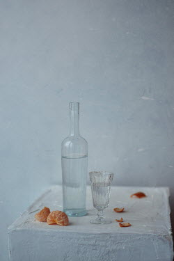 Andreeva Svoboda Water on bottle with glass and mandarin