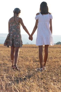 Galya Ivanova Teenage girls holding hands in field