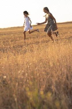 Galya Ivanova Teenage girls running in field