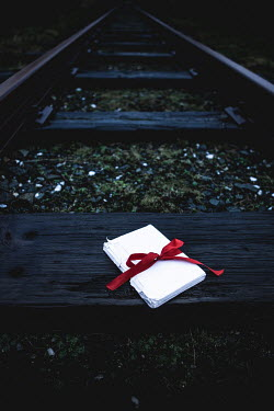 Marie Carr Envelopes with red ribbon on train track