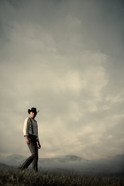 Magdalena Russocka cowboy walking in field