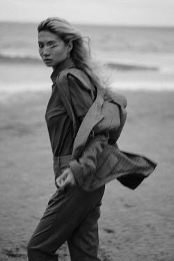 Maria Yakimova Young woman in suit on beach