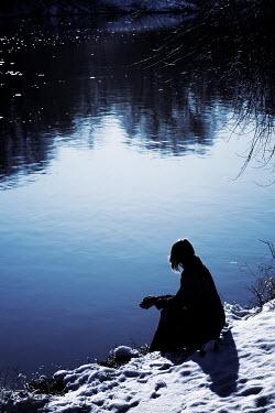 Wojciech Zwolinski Young woman sitting by lake