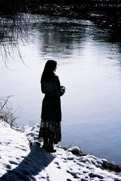 Wojciech Zwolinski Young woman standing by lake