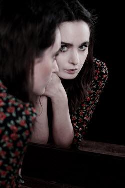 Wojciech Zwolinski Young woman in mirror