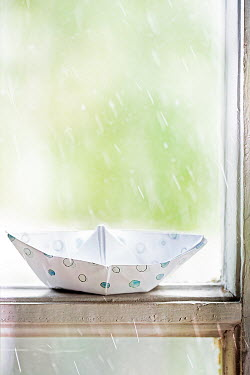 Alison Archinuk Origami paper boat on wooden window sill