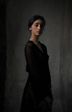 Daniel Murtagh Young woman in black dress under shadow
