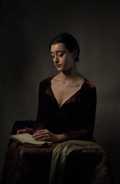 Daniel Murtagh Young woman in black dress reading