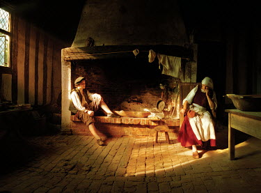 John Foley Man and woman sitting by fireplace