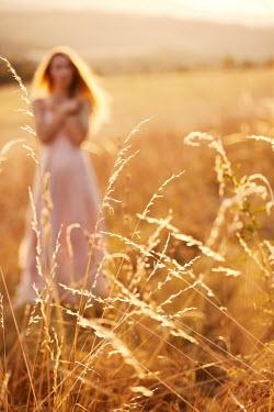 Kerstin Marinov Grass and woman in dress standing in field
