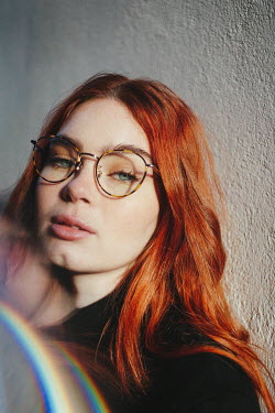 Matilda Delves Young woman with red hair and glasses