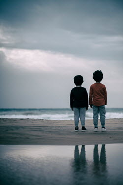 Mohamad Itani Brothers standing on beach