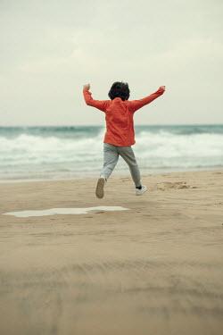 Mohamad Itani Boy jumping on beach