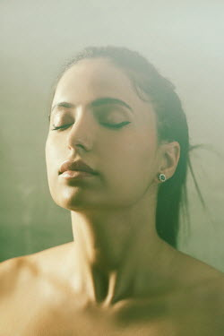 Mohamad Itani Young woman with eyes closed