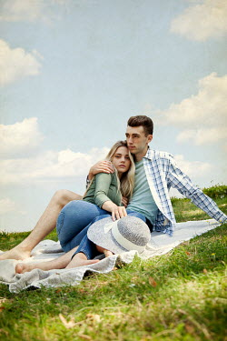 Miguel Sobreira Young couple sitting on hill