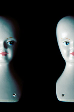 Miguel Sobreira Doll's heads on black background