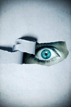 Miguel Sobreira Eye behind torn paper