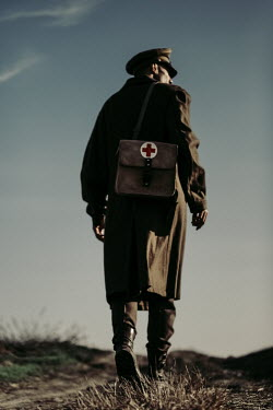 Magdalena Russocka wartime medic soldier walking in field