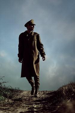 Magdalena Russocka wartime soldier walking in field