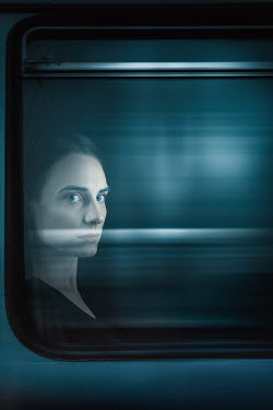 Magdalena Russocka young woman in window of train