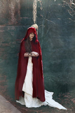 Susan Fox Young woman in red cloak by cliff