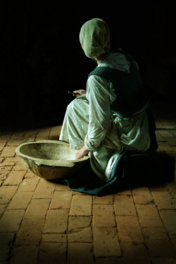 John Foley Maid working with wooden bowl
