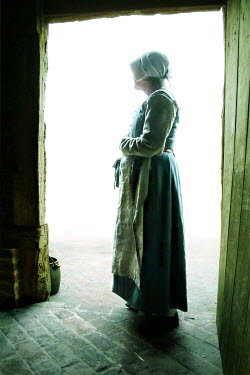 John Foley Maid standing in doorway