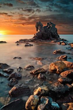David Keochkerian Sunset over rocks in sea