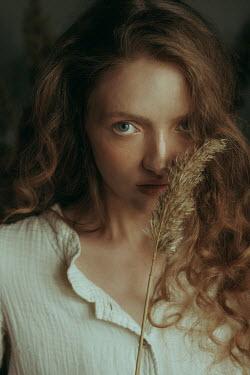 Maria Yakimova Young woman holding grass