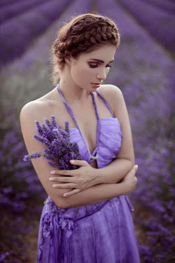 Nathalie Seiferth Young woman in purple dress holding lavender in field