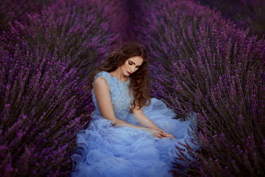 Nathalie Seiferth Young woman in blue dress sitting in lavender field