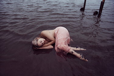 Nathalie Seiferth Topless young woman lying in water on beach