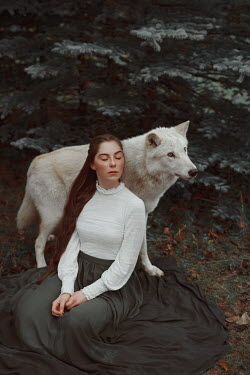 Nathalie Seiferth Young woman with wolfdog