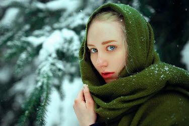 Nathalie Seiferth Young woman with green headscarf in snow