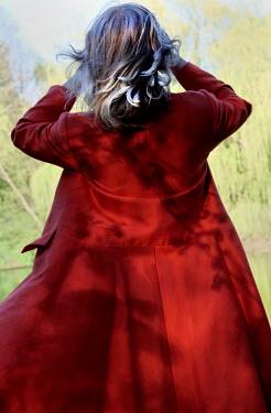 Ute Klaphake BLONDE WOMAN IN RED COAT OUTDOORS Women