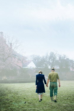 Elisabeth Ansley WARTIME COUPLE HOLDING HANDS BY HOUSE IN COUNTRYSIDE Couples