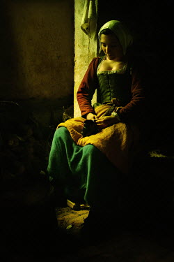 John Foley MEDIEVAL WOMAN SITTING BY HEARTH IN SHADOW Women