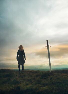 Mark Owen WOMAN AND SWORD IN FIELD AT DUSK Women